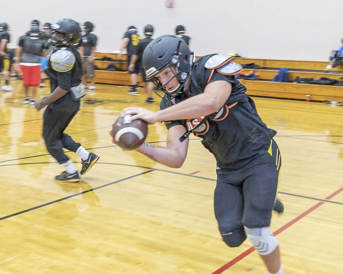 Senior Carter Morse catches a pass at a recent Hudson's Bay practice, forced indoors due to air quality concerns. Photo by Mike Schultz