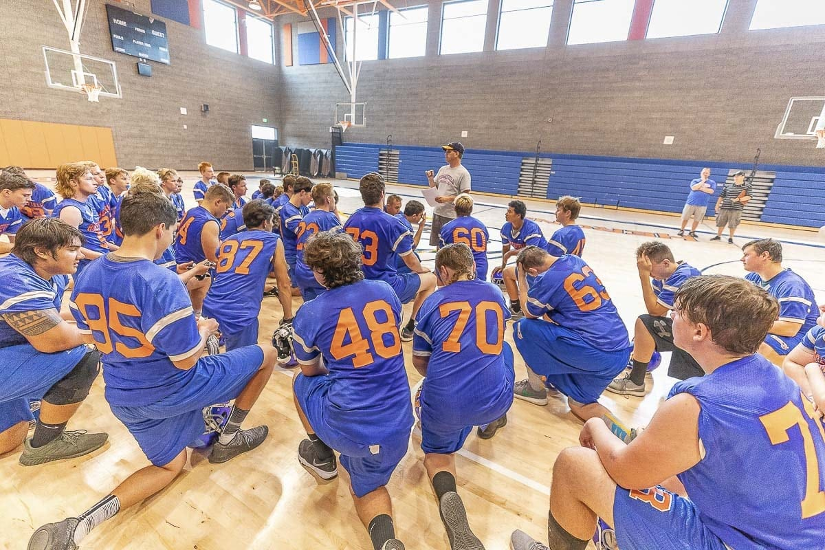 Ridgefield coach Chris Abrams gives a post-practice talk to the Spudders. Photo by Mike Schultz