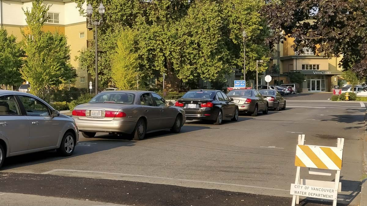 Cars line up outside the ballot drop box in downtown Vancouver less than an hour before the deadline on Tuesday. Photo by Chris Brown