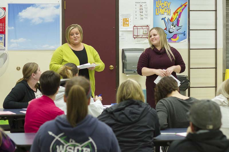 Sonya Stemkoski (left) and Felicity Ottis (right) taught parents from the Woodland Co-Op Preschool techniques for educating children about disabilities. Photo courtesy of Woodland Public Schools