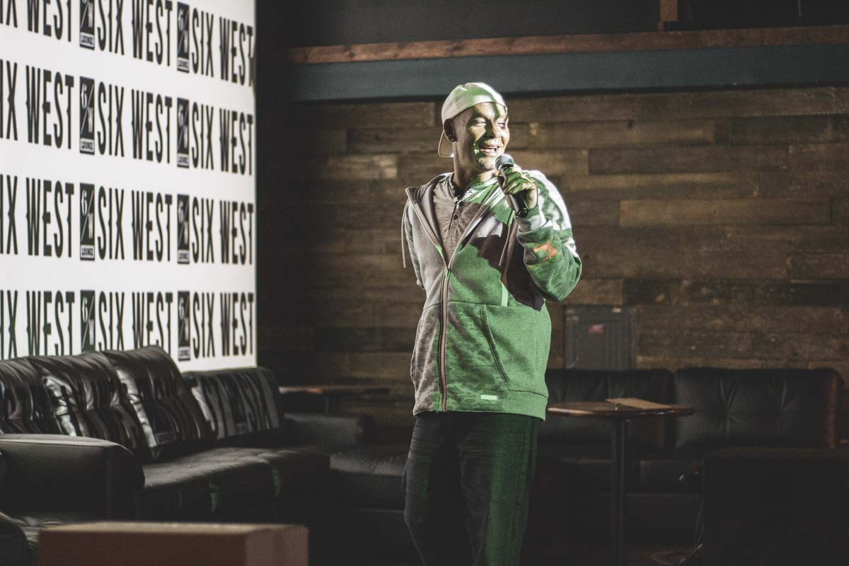 Junior Shaw livens up the crowd at a team karaoke battle hosted by his karaoke league from Longview. Photo by Jacob Granneman
