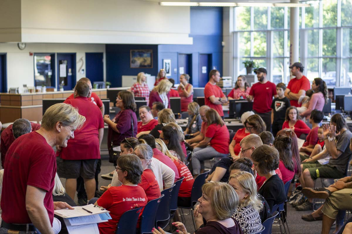 Parents, teachers, and students mingle before the Hockinson School Board meeting at the high school library. Photo by Jacob Granneman