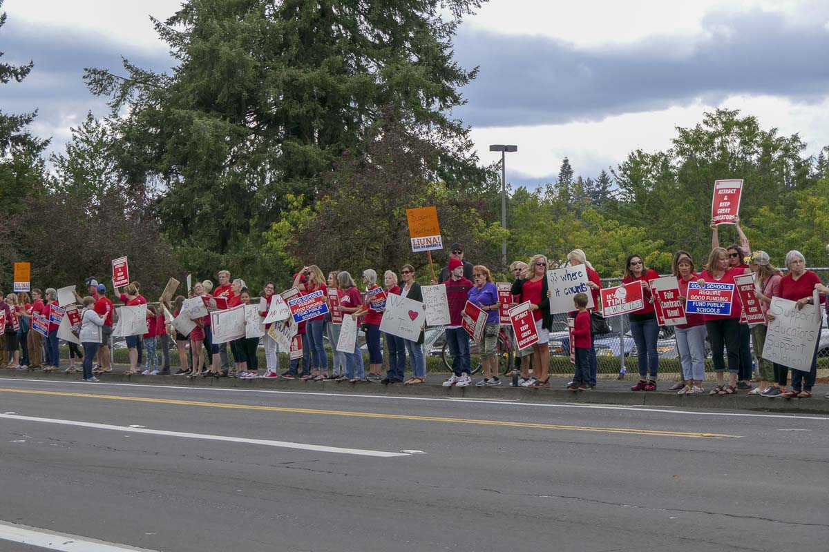 People line Falk Road on Monday afternoon in support of Vancouver teachers who have voted to strike starting Wednesday if a deal isn't reached. Photo by Chris Brown