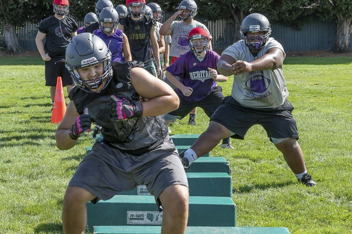 The Heritage Timberwolves have been hard at work this week preparing for the 2018 high school football season. Photo by Mike Schultz