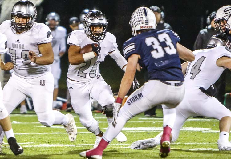 Senior running back JoJo Siofele (26) is one of many standout skill position players returning for the Union Titans this season. Photo by Mike Schultz