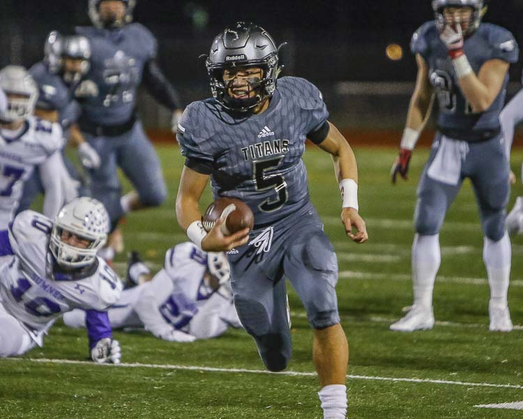 Senior Lincoln Victor (5) is back at quarterback for the Union Titans in 2018. Photo by Mike Schultz