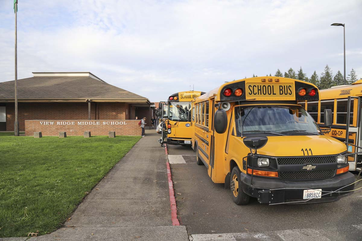 Buses wait outside Union Ridge School in Ridgefield (file photo). Photo by Mike Schultz