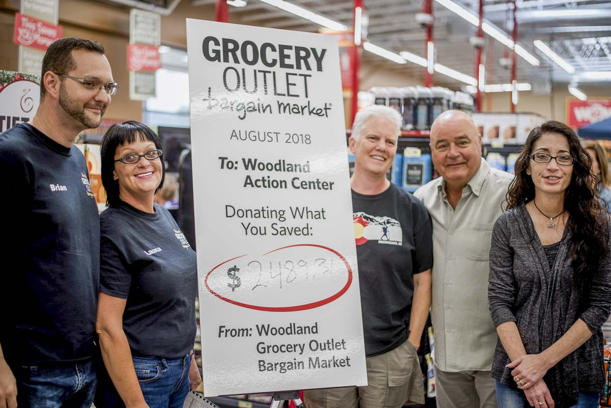 Woodland Grocery Outlet owner-operators Brian and Launa Howard (left) present Woodland Action Center board members with a donation check of $2,489.31. Photo courtesy of Woodland Grocery Outlet