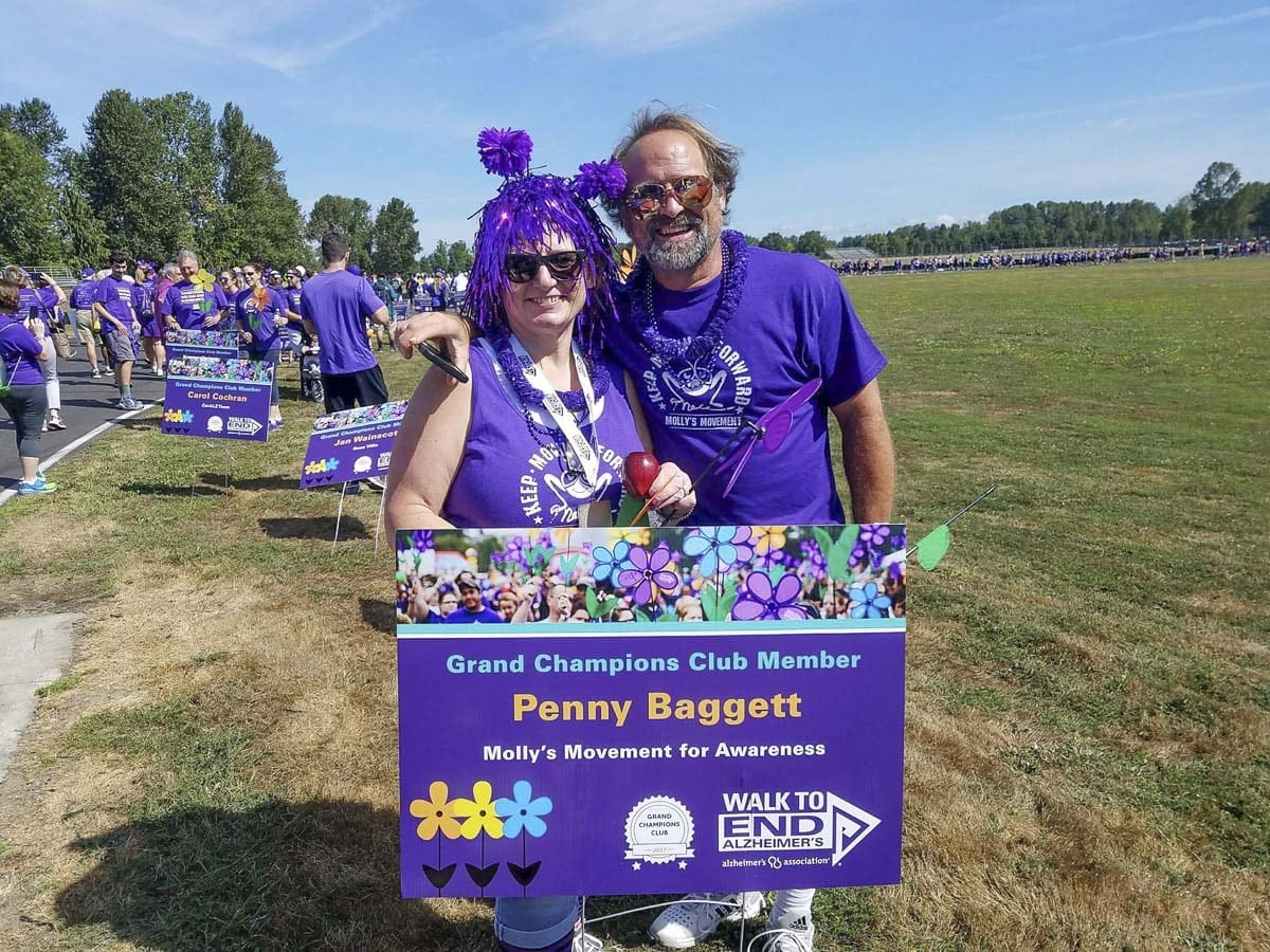Penny Baggett and her husband at a previous Walk to End Alzheimer's. Penny is a grand champion club member because of her contributions and fundraising efforts for Alzheimer's research. Photo courtesy of Penny Baggett