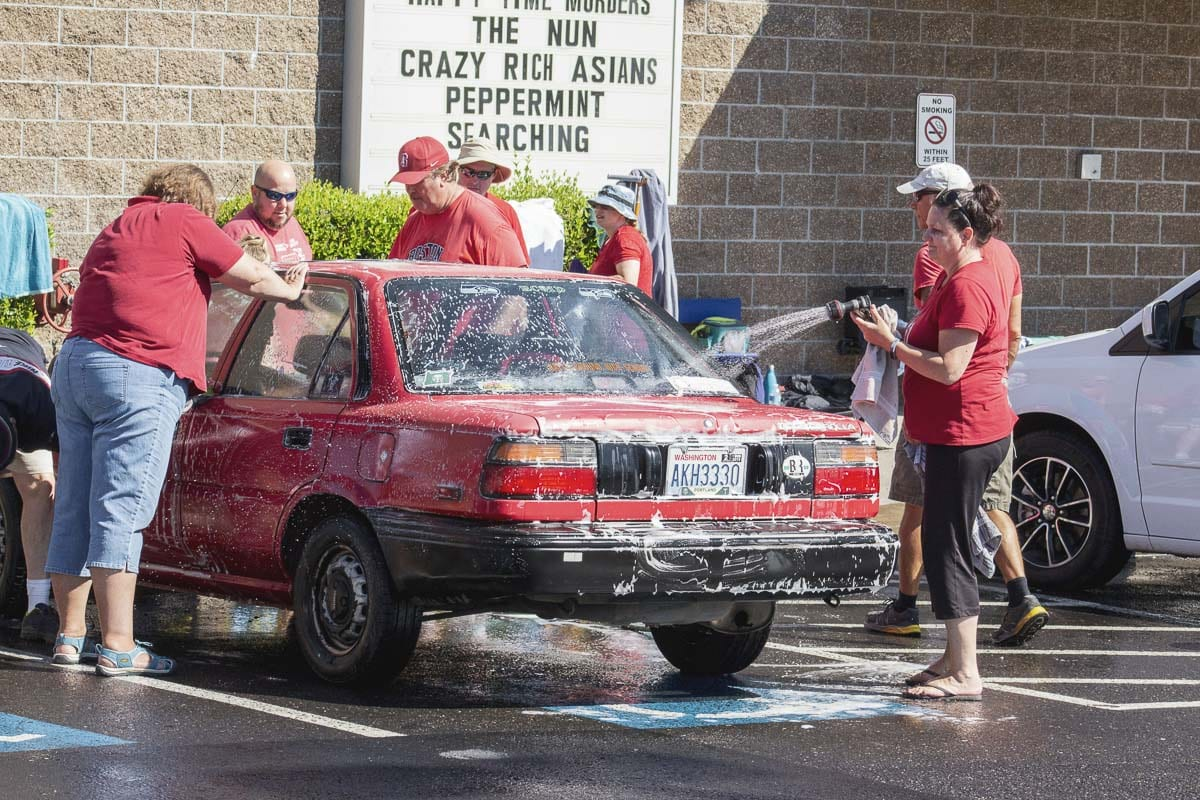 Striking Battle Ground teachers held a day of community service events Friday, including a car wash at Battle Ground Cinemas to raise money for the local food bank. Photo by Jacob Granneman