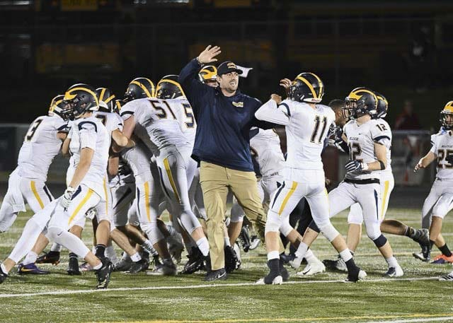 Bellevue's players and coaches celebrate after the Wolverines' game-winning field goal on the final play, which gave Bellevue a 38-35 non-league victory over Camas at Doc Harris Stadium. Photo courtesy of Kris Cavin