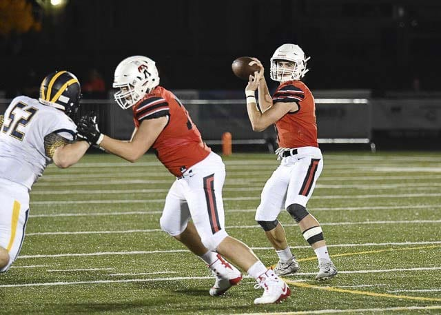 Camas quarterback Andrew Boyle (4) drops back for a pass Friday in the Papermakers' loss to Bellevue. Boyle threw for 292 yards and five touchdowns. Photo courtesy of Kris Cavin