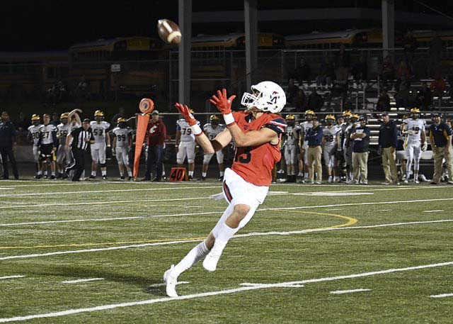 Camas receiver Luc Sturbelle (13) hauls in a pass in Friday's action against Bellevue. Sturbelle had three touchdown catches for the Papermakers in a 38-35 loss at Doc Harris Stadium. Photo courtesy of Kris Cavin