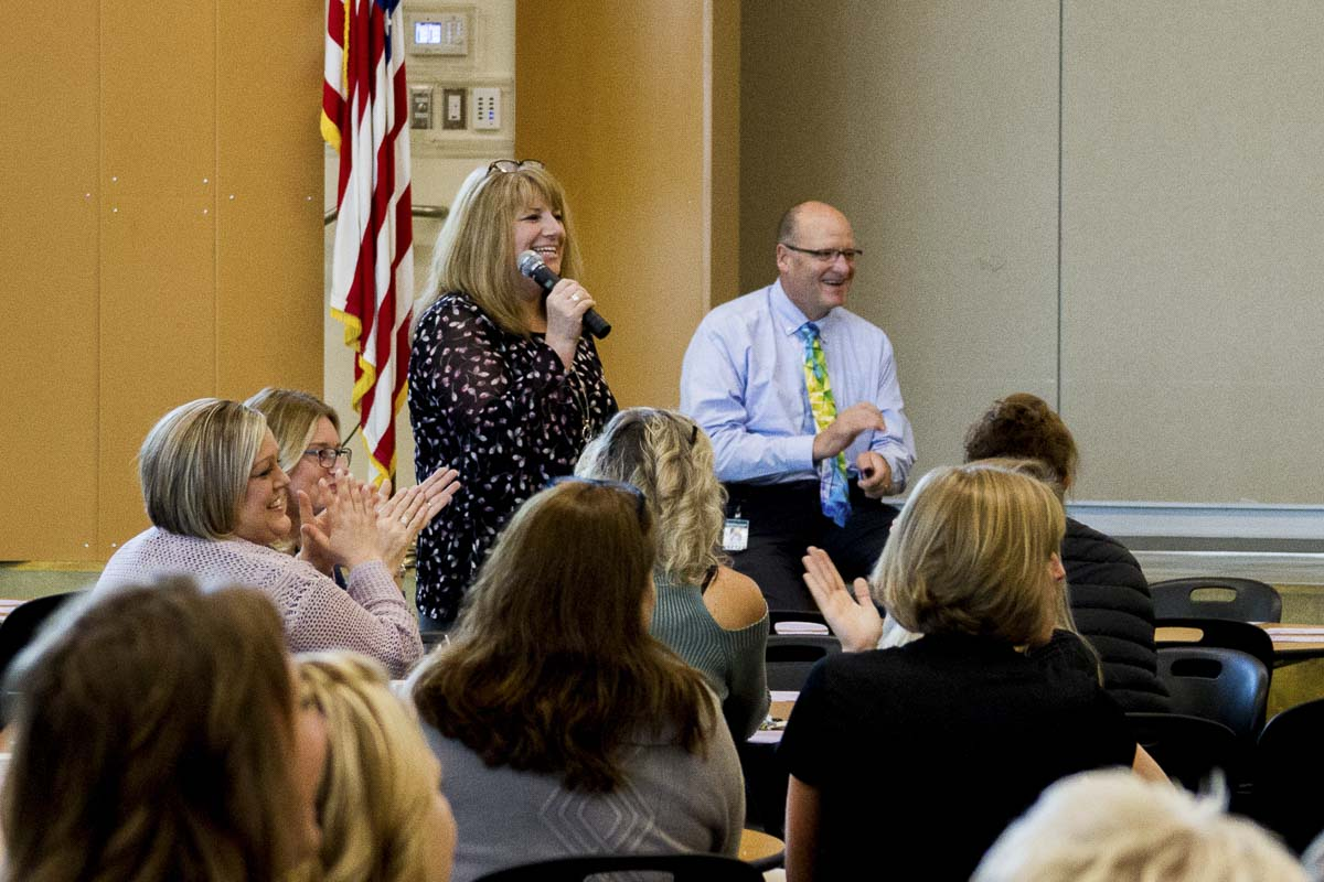 New Woodland Intermediate School Principal Denise Pearl introduces other staff members added to her school during the annual collaborative all-staff kick-off breakfast meeting. Photo courtesy of Woodland Public Schools