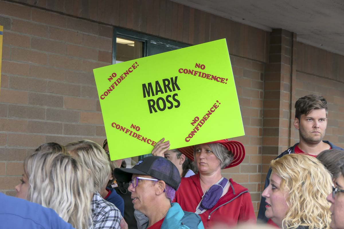 A Battle Ground resident holds a sign ahead of Monday's school board meeting. Photo by Chris Brown
