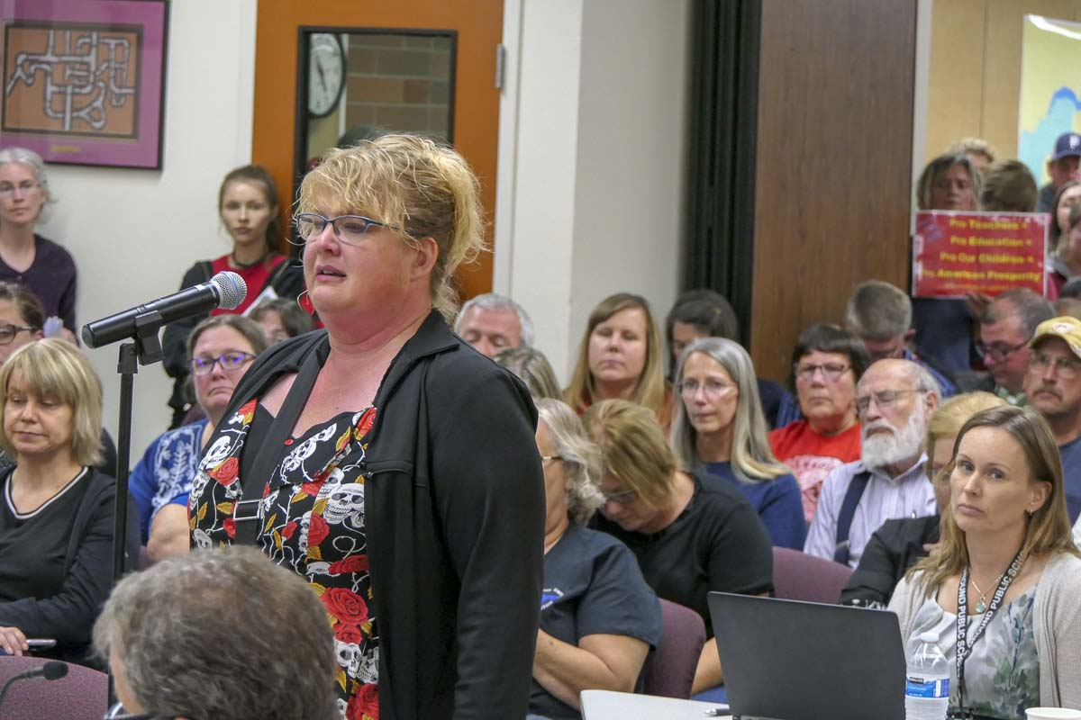 Heather Williams, a science teacher at River Homelink fights back tears while addressing the board. Photo by Chris Brown