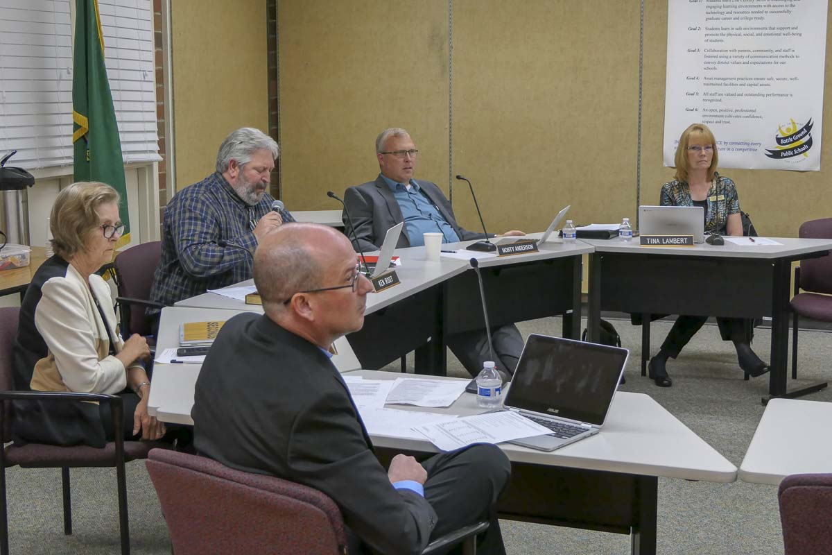 The Battle Ground Board of Directors listen as citizens give public comment at Monday's meeting. Photo by Chris Brown