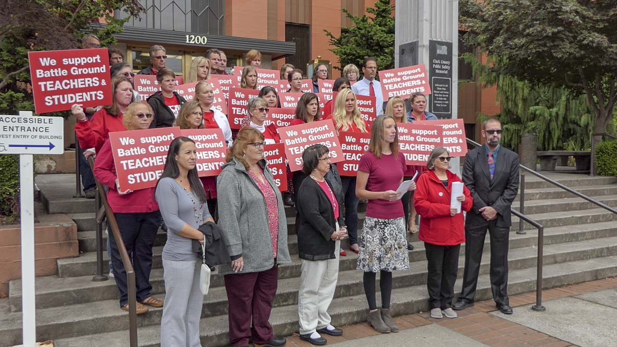 Battle Ground teachers and union reps stand outside the Clark County Courthouse before an injunction hearing on Friday. Photo by Chris Brown