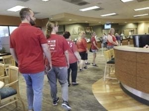 Evergreen school teachers marched into a Columbia Credit Union managed by school board Director Julie Bocanegra on Tuesday, to tell her Superintendent John Steach wasn't bargaining in good faith. Photo courtesy Evergreen Education Association