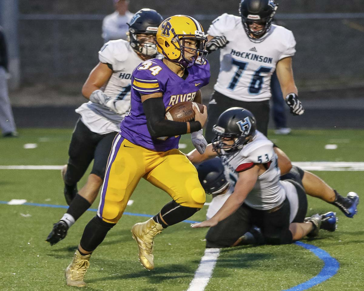 Columbia River running back Jackson Fobbs (34) races up field in Friday's Class 2A Greater St. Helens League action at Columbia River High School. Photo by Mike Schultz