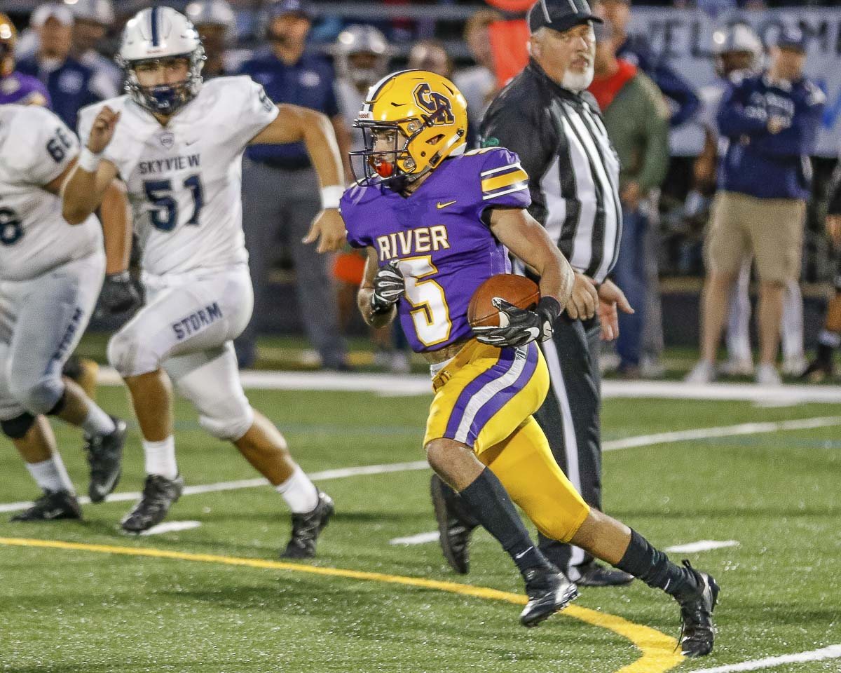 Columbia River's Jarrett Seelbinder, shown here earlier this season against Skyview, had a touchdown catch and a punt return for a touchdown in his team's win over Ridgefield. Photo by Mike Schultz