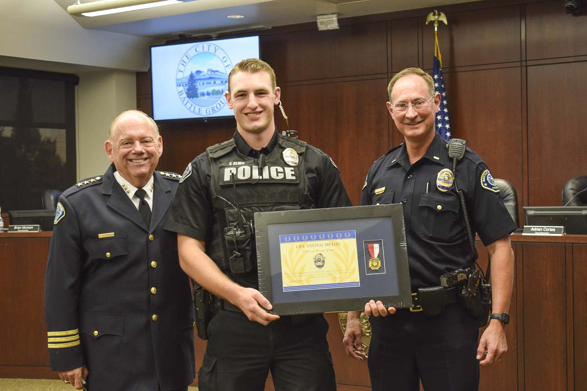 Battle Ground Officer Trent Elms (center) is presented with a Life Saving Award by members of the city of Battle Ground Police Department including Chief Bob Richardson (left) and Lieutenant Mike Fort (right). Photo courtesy of city of Battle Ground
