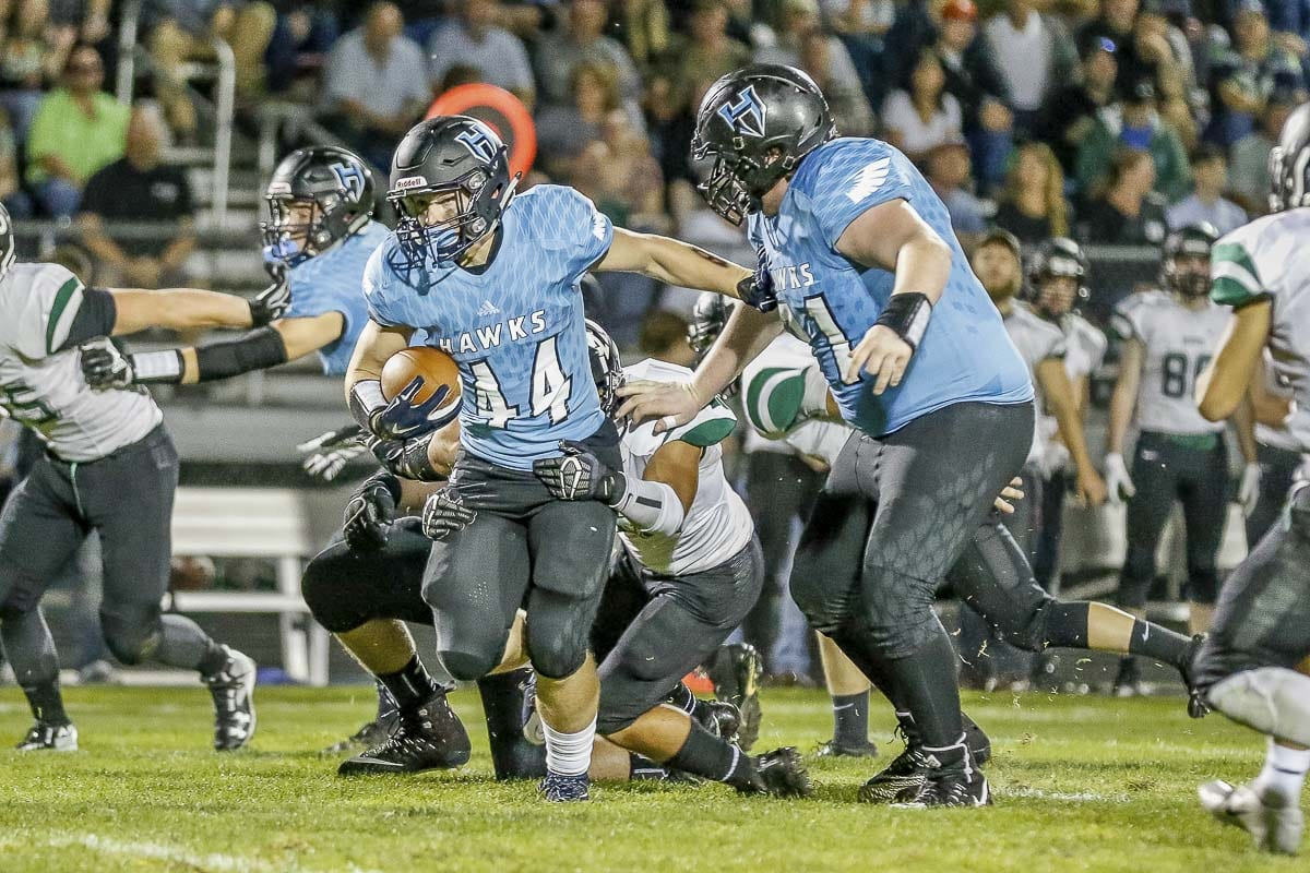 Hockinson running back Cody Wheeler (44) attempts to break free from a Woodland defender during the Hawks' win Friday. Photo by Mike Schultz