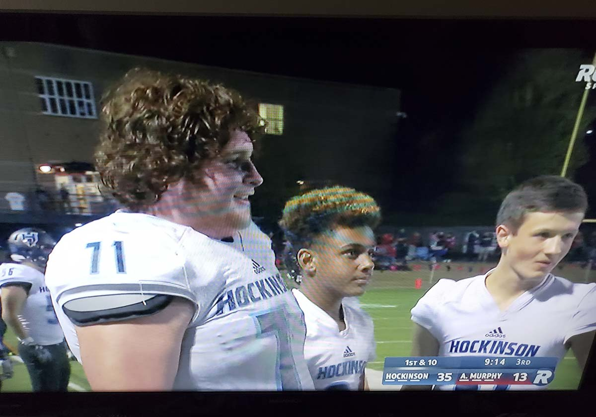 Nathan Balderas was all smiles on the sideline last week, captured here in a photo off a TV screen. Yes, the Hockinson Hawks were on regional TV. Balderas got the spike heard round the Northwest, and Hockinson got a big victory. Photo by Paul Valencia