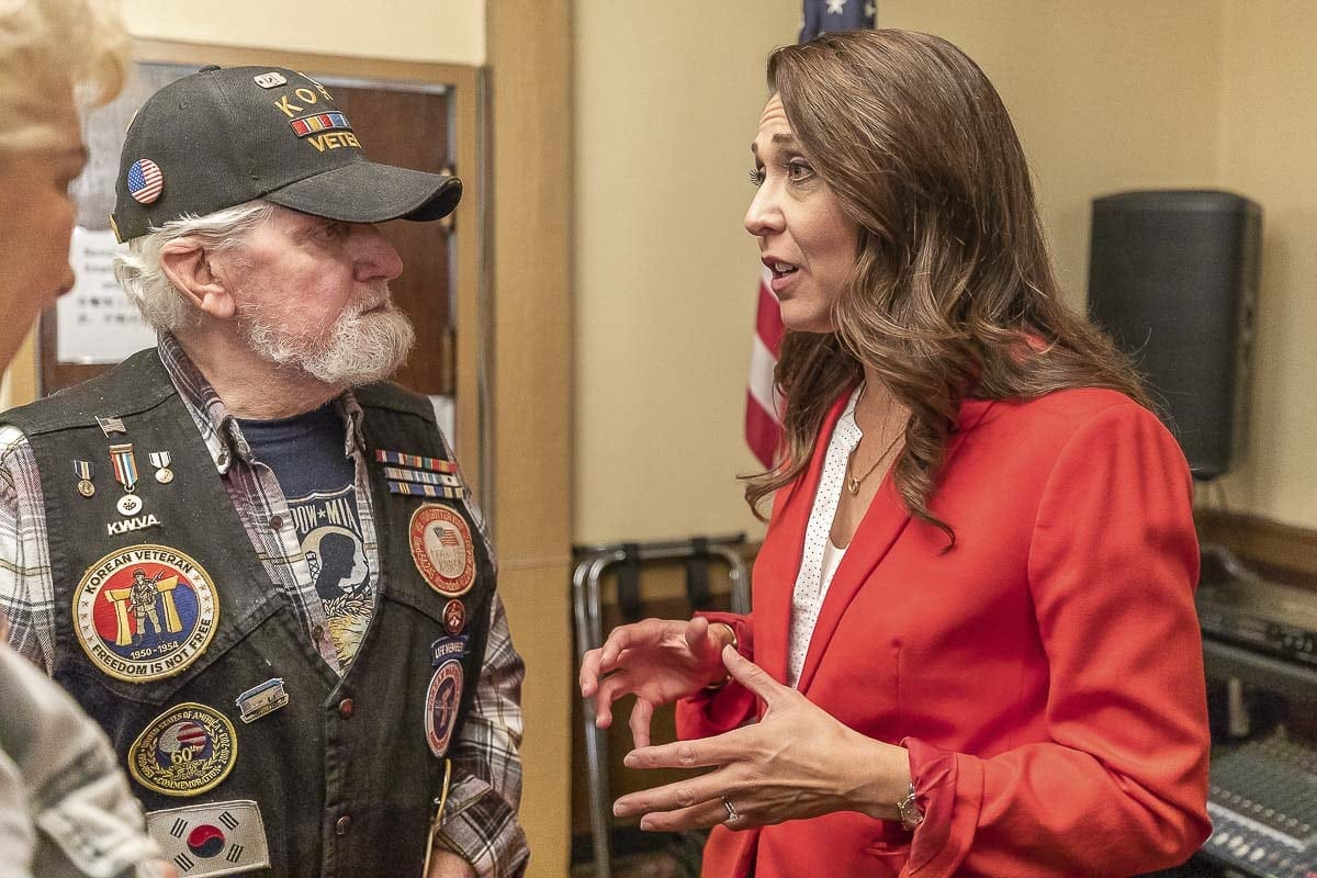 Congresswoman Jaime Herrera Beutler meets with Korean War veteran Bobby Worden during the 3rd congressional candidate forum hosted by the Woodland Chamber of Commerce. Photo by Mike Schultz
