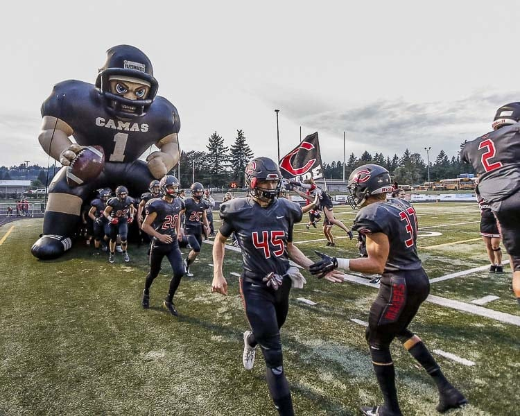 The atmosphere at Doc Harris Stadium, pictured here last season, is a treat. Huge band, special effects such as smoke during pre-game, and, of course, the running through Kong the Papermaker. Camas returned home in Week 2 of the 2018 season with a win, improving to 45-3 at home since the opening of the new Doc Harris Stadium. Photo by Mike Schultz