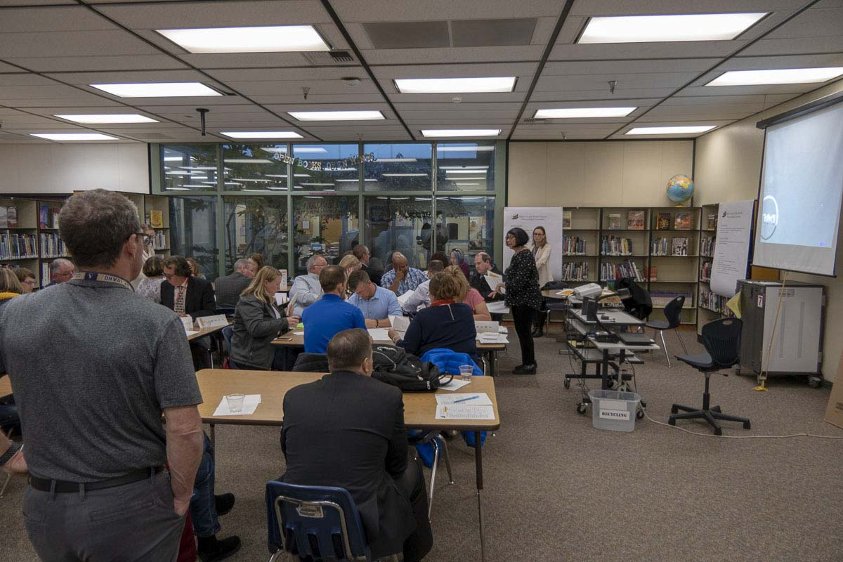 The 30-member Battle Ground Schools Overcrowding Committee meets in the library at Pleasant Valley Middle School. Photo by Chris Brown