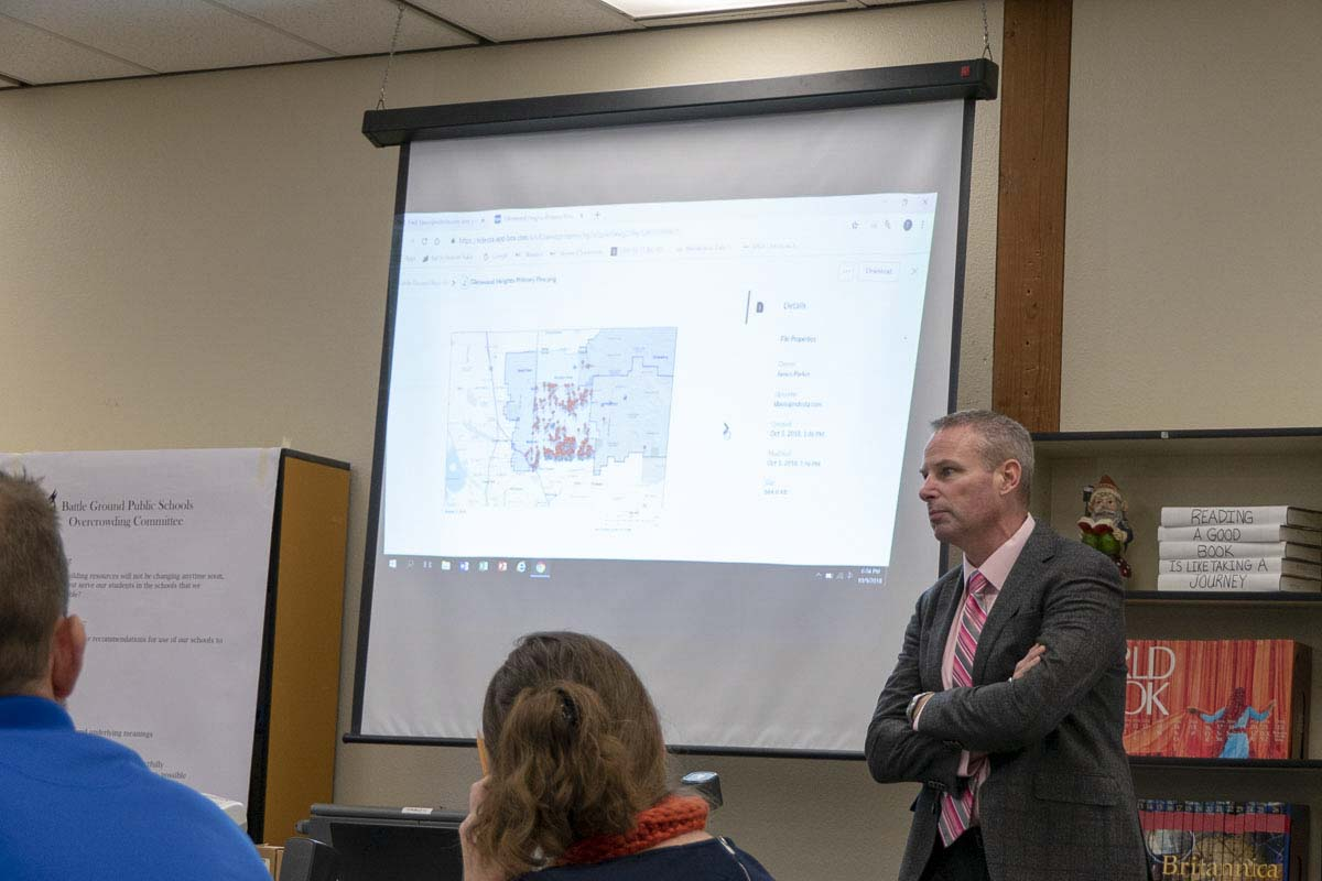 Tom Adams, director of student services for Battle Ground Schools, answers questions about bus routes for the BGSD Overcrowding Committee. Photo by Chris Brown