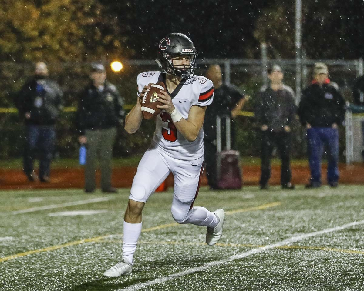 Camas quarterback Jake Blair (3) has his eyes focused downfield as he rolls out for a pass attempt in the Papermakers' loss to Union Friday at McKenzie Stadium. Photo by Mike Schultz