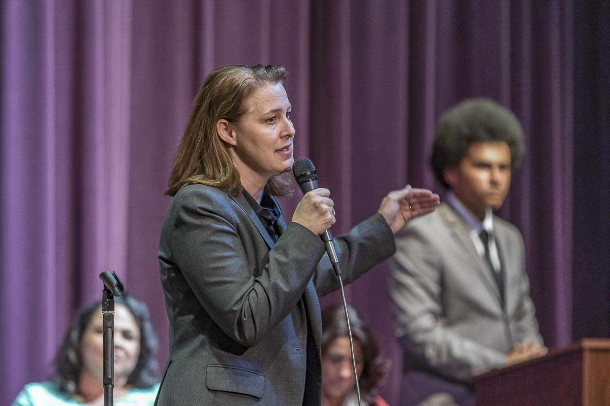 Candidate for the 3rd Congressional District, Carolyn Long (D), gives her opening statements at Thursday's public forum, hosted by Heritage High Schools AP Government class. Photo by Mike Schultz