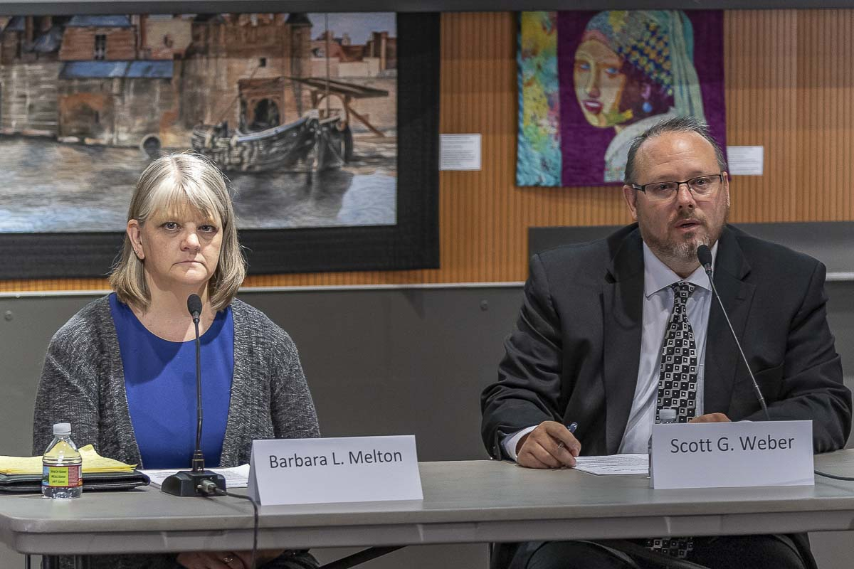 Incumbent candidate for Clark County Clerk, Scott G. Weber, (right), is shown here with his opponent Barbara L. Melton, (left), at a League of Women Voters forum on Oct. 16. Photo by Mike Schultz