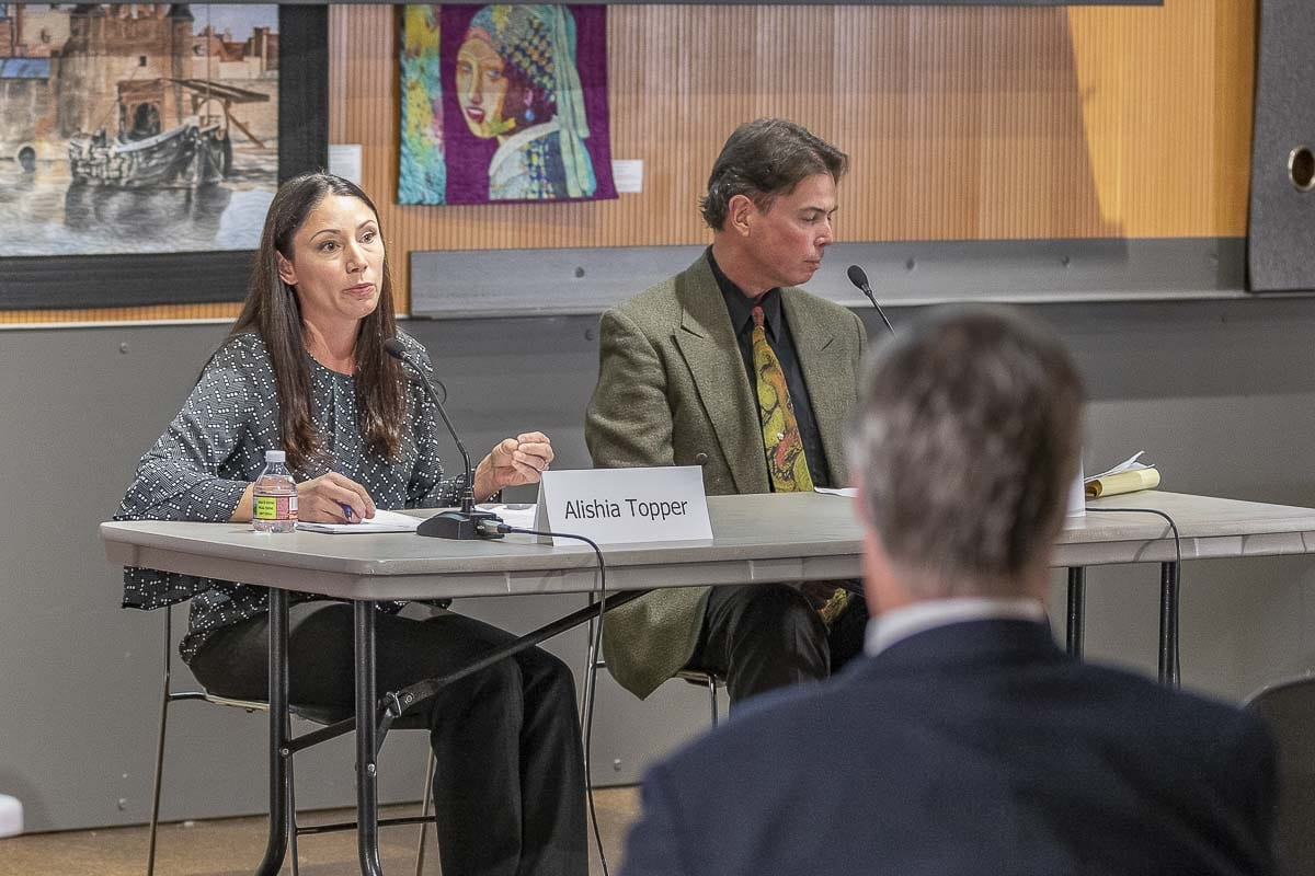 Candidates for Clark County Treasurer, Alishia Topper, (left), and Robert Hinds, (right), are seen here participating in a League of Women Voters forum on Oct. 16. Photo by Mike Schultz