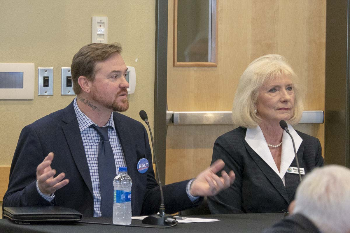 Eric Holt and Eileen Quiring, candidates for Clark County Chair, answer questions at a League of Women Voters candidate forum at Battle Ground Community Center on Thursday. Photo by Chris Brown