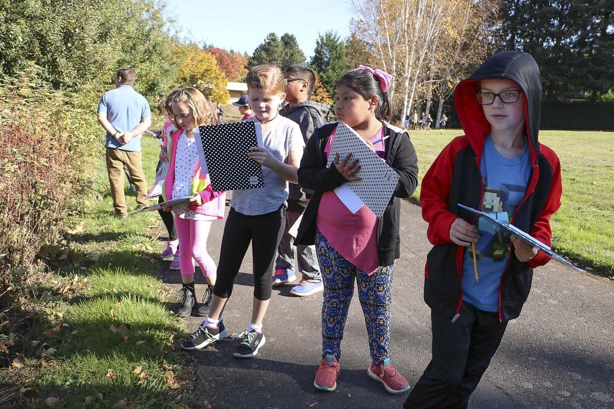 Third graders from Pleasant Valley Primary School collect data while looking for native plants. Photo courtesy of Battle Ground School District