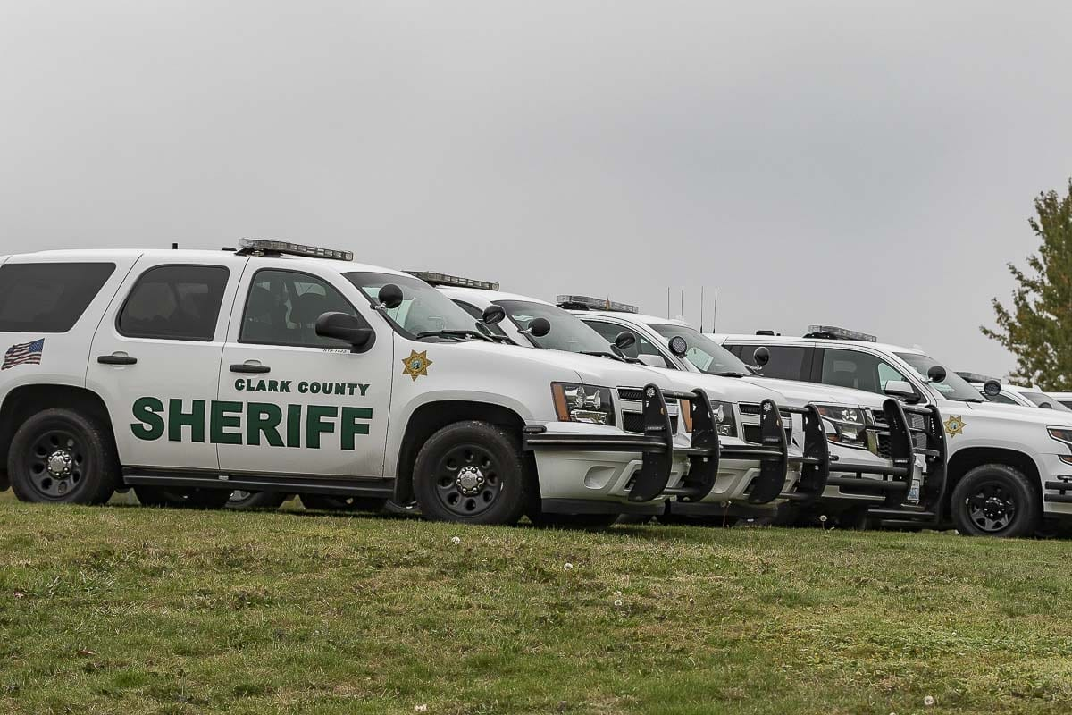 Clark County Sheriff's Office vehicles line a lawn on the WSU Vancouver campus in sight of a rally by Patriot Prayer. Photo by Mike Schultz