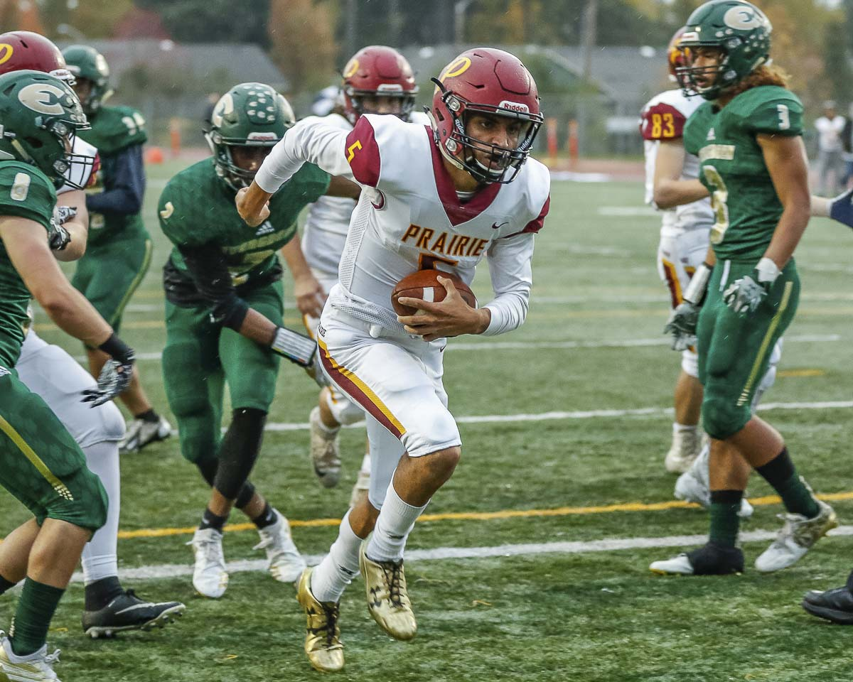 Prairie quarterback A.J. Dixson (5) runs for one of his two touchdowns during the Falcons' 34-7 win over Evergreen Friday at McKenzie Stadium. Photo by Mike Schultz