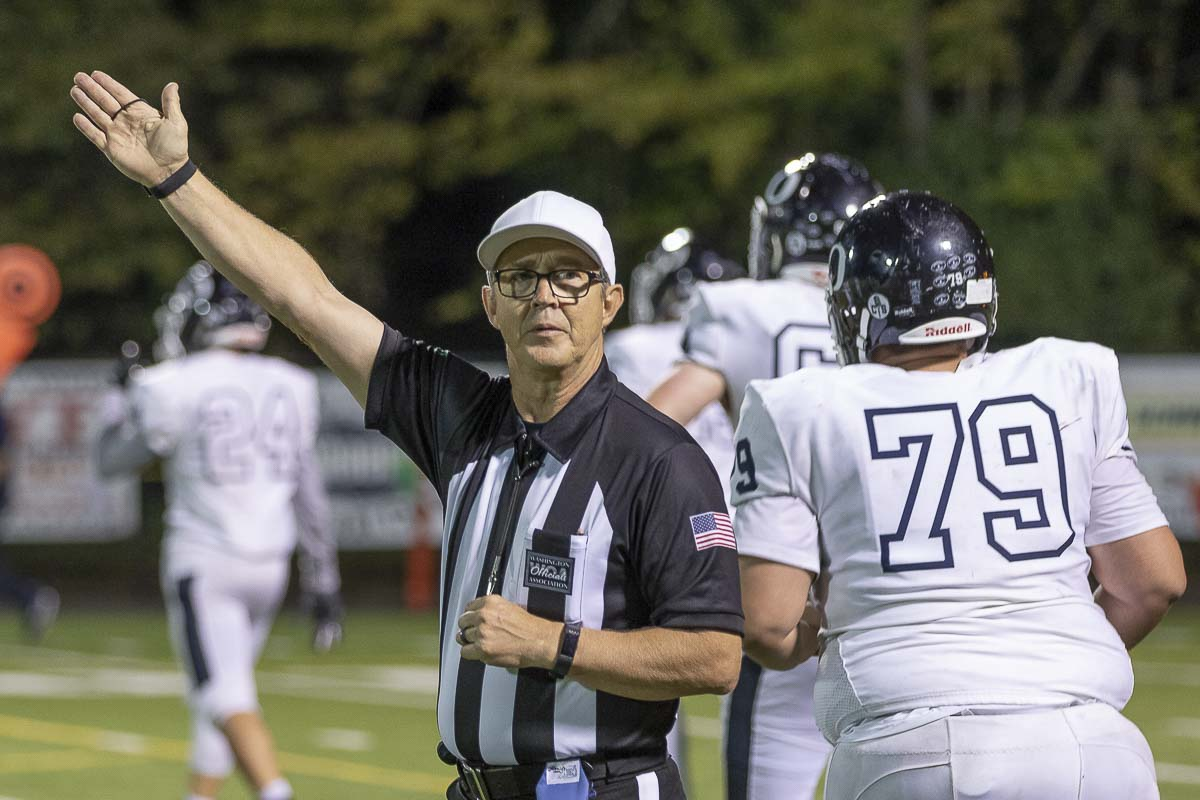 Jim Goss signals first down at a recent Skyview game. Photo by Mike Schultz