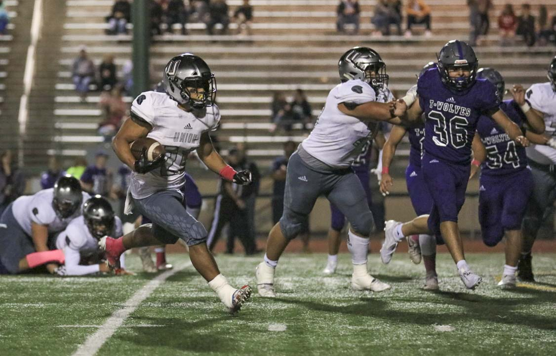 Union's Jojo Siofele rushed for 96 yards and a touchdown, helping the Titans beat Heritage 34-0 Thursday night. Photo courtesy of Heather Tianen