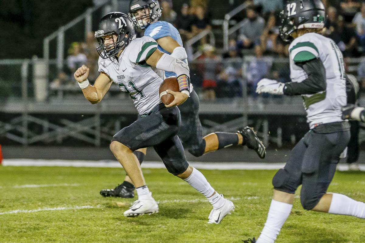 Tyler Flanagan can run or pass to pick up the yards for the Woodland Beavers. He had another impressive night, even in a loss, last week against No. 1 Hockinson. Photo by Mike Schultz