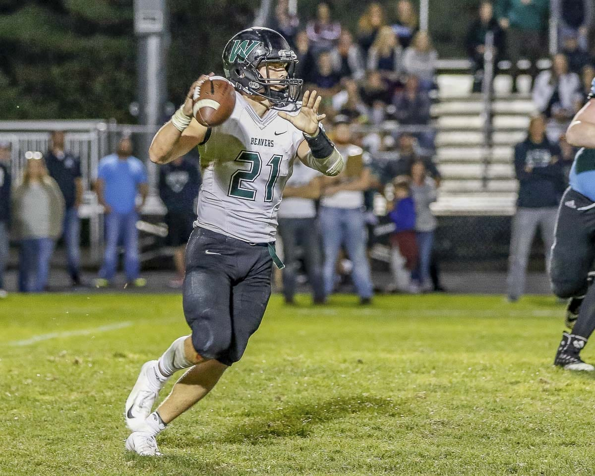 Woodland quarterback Tyler Flanagan has more than 1,400 yards passing and 1,200 yards rushing this season. The Beavers take on Columbia River this week in a crucial 2A GSHL contest. Photo by Mike Schultz