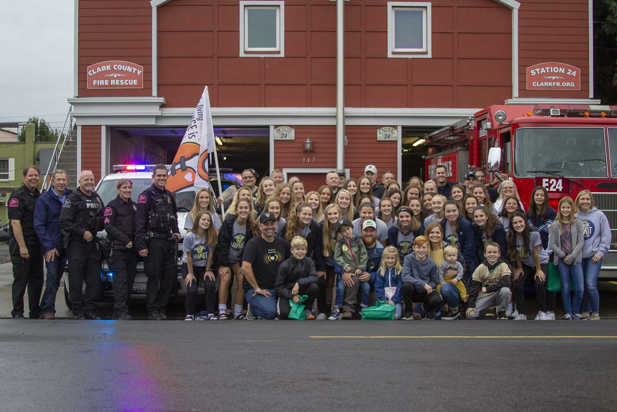 "Members of the Clark County Sheriff's Office, the Ridgefield Police Department, Clark County Fire and Rescue, the Hockinson High School girls soccer team, and representatives from the NBA pose for a group photo at Wyatt's Kindness ""Sting"" Friday, Oct. 26. Photo by Jacob Granneman"