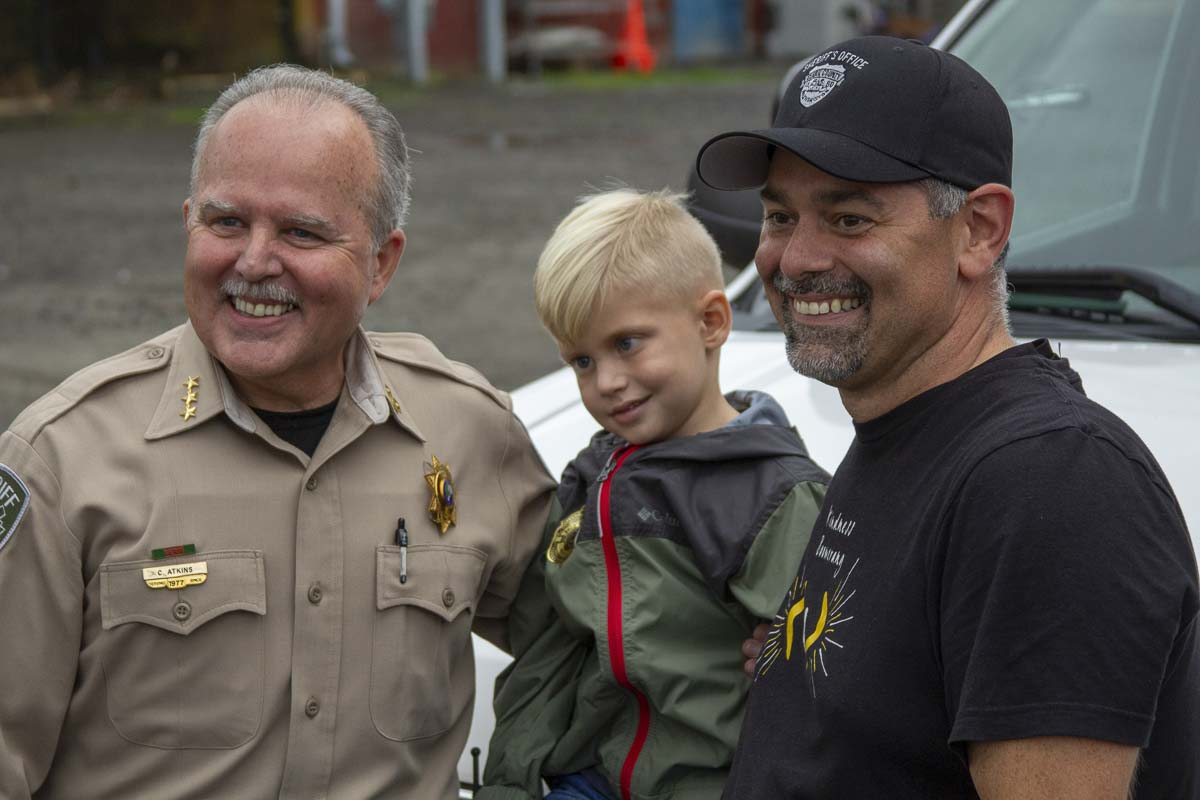 Clark County Sheriff Chuck Atkins and Jason Hattrick of Life Vest Inside, pose with Wyatt Draper at a surprise event for Wyatt last week. Photo by Jacob Granneman