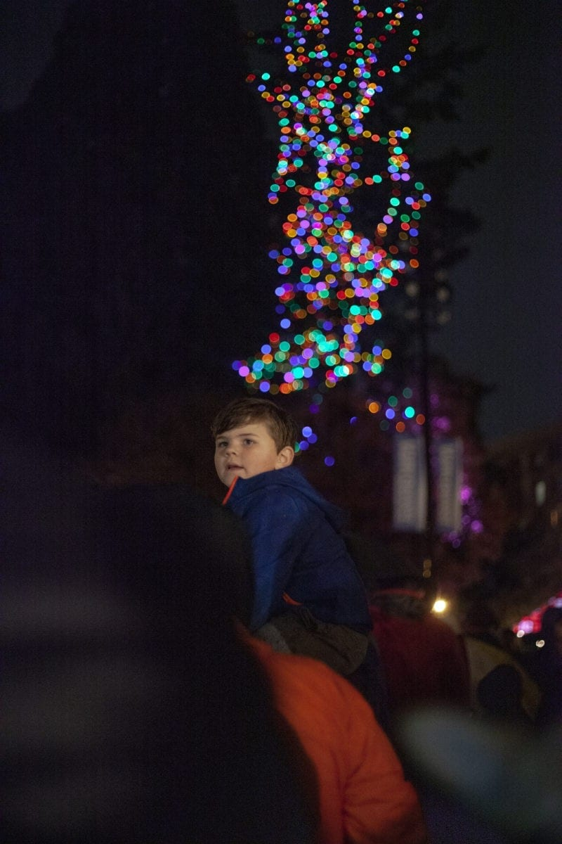 Griffin Stixrud sits atop his mother Casie's shoulders to watch the tree light up at the Vancouver tree lighting. The event was hosted by area businesses and churches, in the square of Esther Short Park. Photo by Jacob Granneman