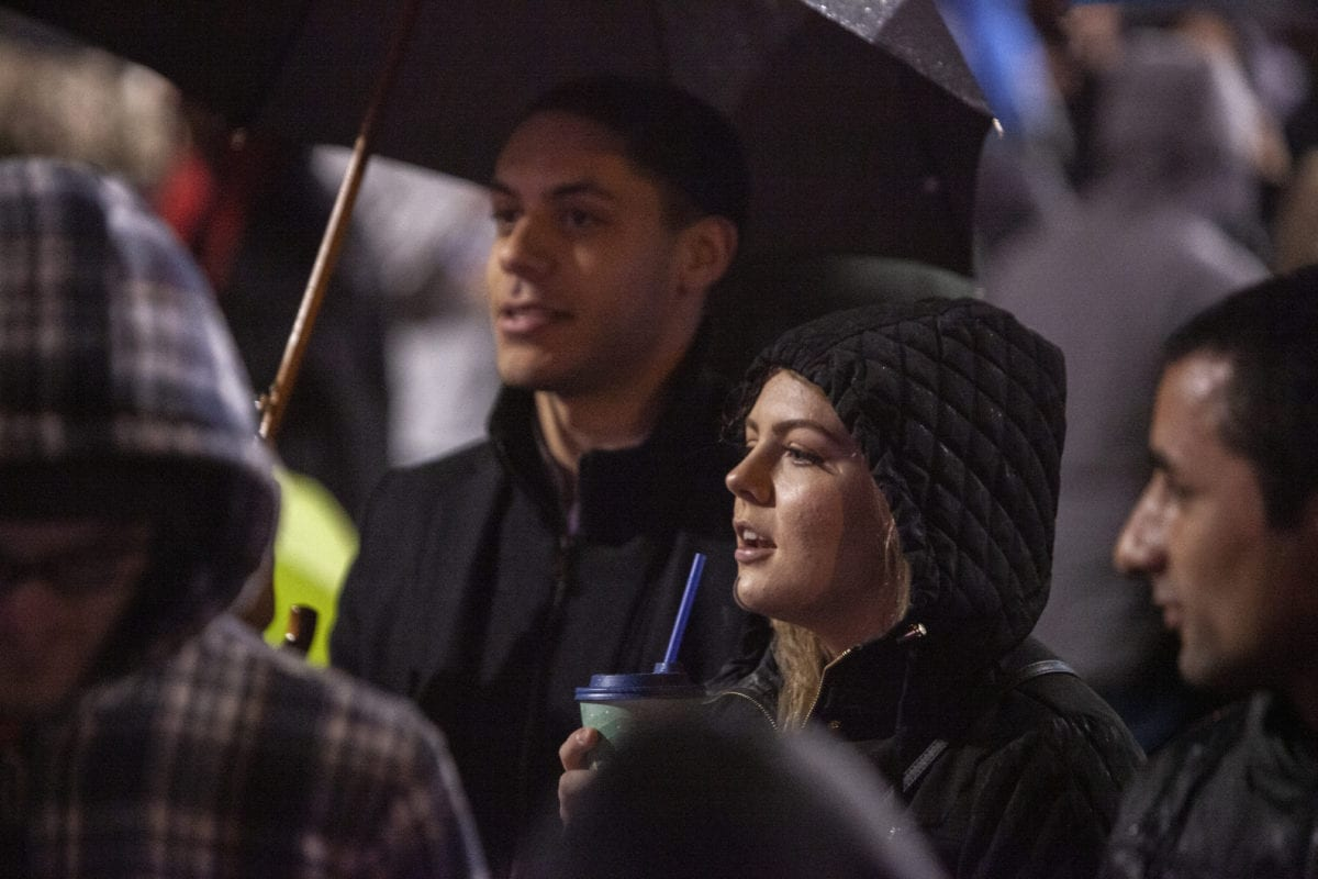 Deontae Peracca and his fiance Rylee Zimmerman sing along with the children's choir as they sing Christmas carols at the Vancouver tree lighting ceremony. Photo by Jacob Granneman