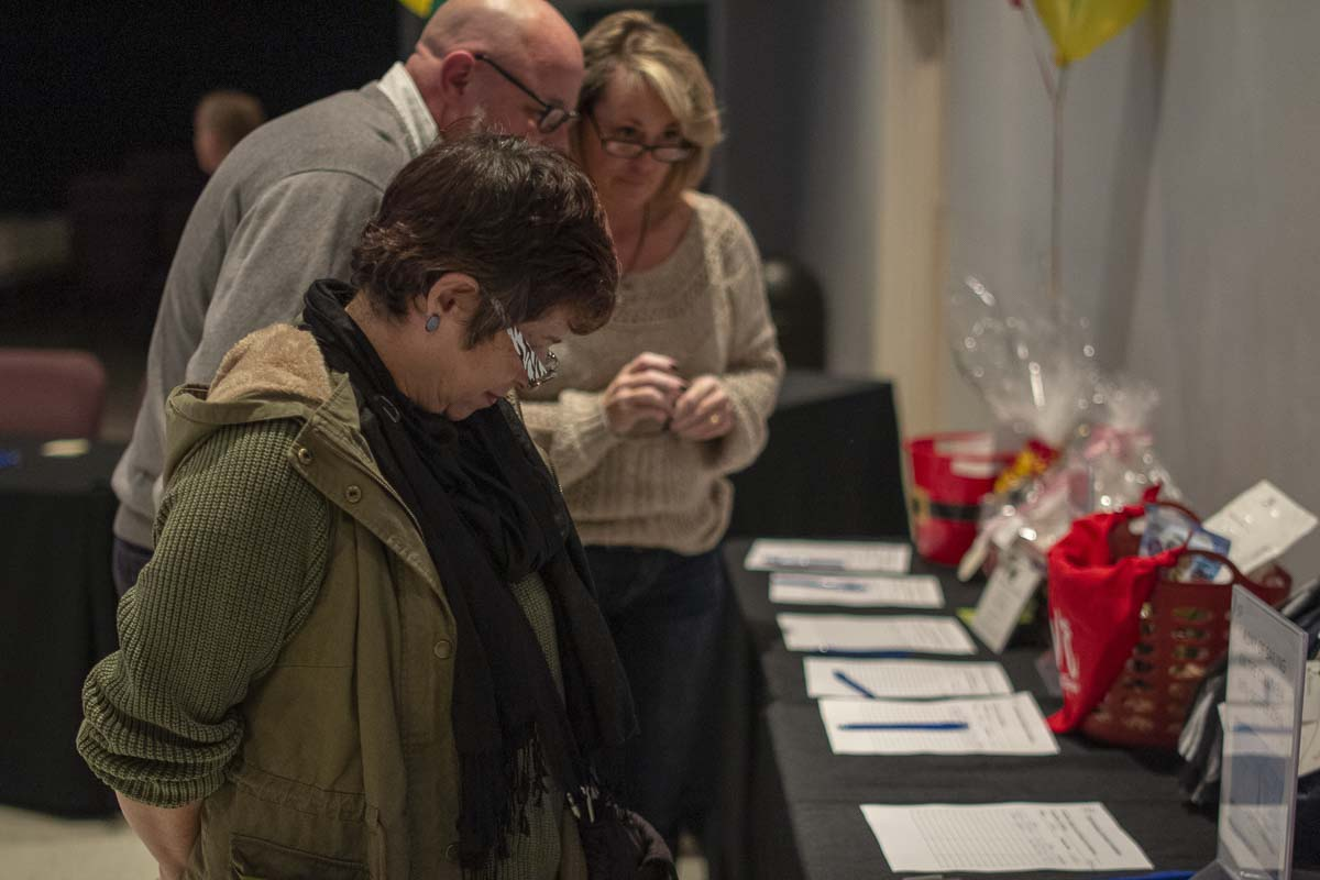 As part of the fundraiser banquet, a silent auction was held to raise additional money for the Live Love Center and services for the homeless this winter. Photo by Jacob Granneman