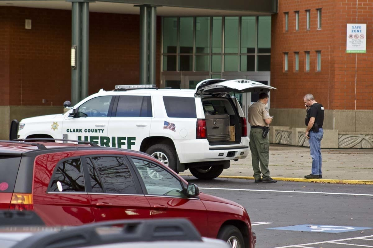 Clark County Sheriff's Office Deputies guard the entrance to Heritage High School. The school was placed under lockdown this afternoon after a suspect fired a gun into the ground. Photo by Jacob Granneman